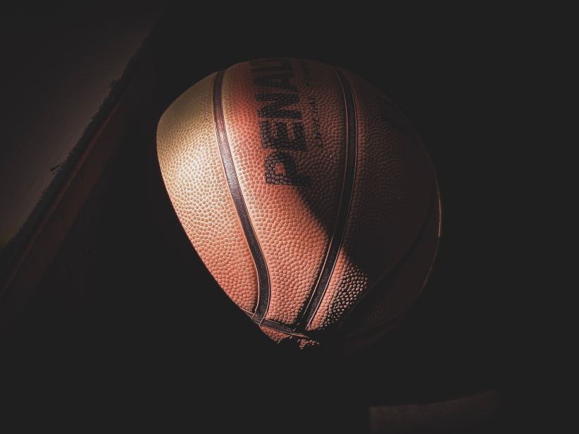 Basketball in low light.